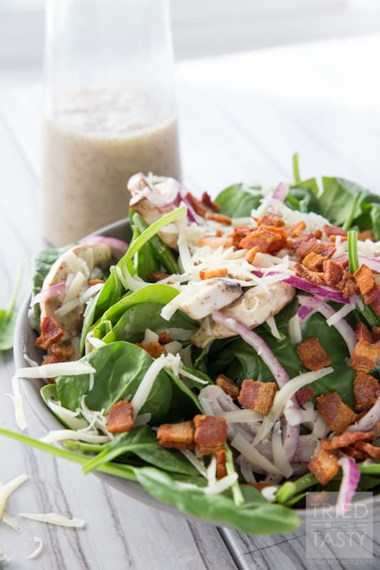 Spinach Salad // You will fall in love at first taste with this salad. A delicious combination of so many wonderful flavors. Great addition to any dinner table spread. Great for BBQ's, picnics, potlucks, or holiday parties. Simple to put together! | Tried and Tasty