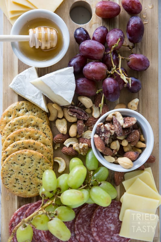 How To Build The Perfect Cheese Board // If you want a show stopper at the beginning of your dinner party, you do not want to miss this excellent how-to. What components do you need? Why do you need them? Your guests will love this perfect combo! | Tried and Tasty