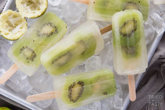 Kiwi Limeade Popsicles // You will fall in love with this cool treat at first lick. Perfectly sweet (without any refined sugar) and wonderfully refreshing. A great addition to your summertime dessert menu! | Tried and Tasty