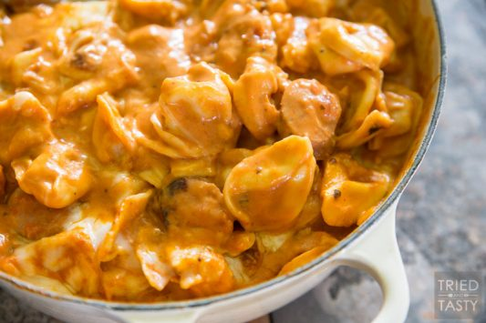 Two-Timin' Tortellini and Sausage // This simple one pot meal is perfect any night of the week. Ready in 30 minutes, tasty enough for the whole family, and with the addition of sausage it's a hearty filling dinner you'll love!   Tried and Tasty