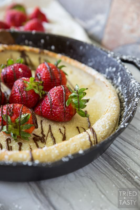 Chocolate Covered Strawberry Dutch Baby Pancakes // You've had a german pancake (or Dutch Baby as they are also called) but have you had this delightful chocolate covered strawberry version? Probably not... but I'm here to change that. This would be the most excellent breakfast to wake up to! | Tried and Tasty