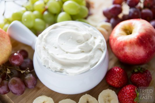 Honey Sweetened- Fruit Dip // Fruit is already sweet, so you don't need a sugar loaded dip to dunk it in. This fruit dip is absolutely perfect. It's light. It's fluffy. And it's *just* sweet enough, and sweetened all naturally with honey! Serve this at your next potluck or party and everyone will want the recipe! | Tried and Tasty