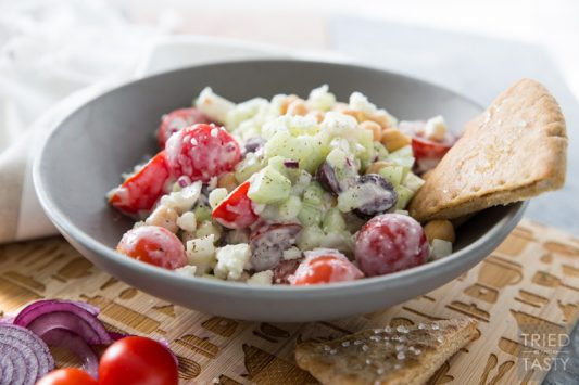 Mediterranean Chickpea Salad // This salad SCREAMS garden goodness! If you're growing tomatoes, cucumber, and dill... I recommend you grab everything else you need to put this together. It's absolutely delightful and perfect paired with homemade baked pita chips!   Tried and Tasty
