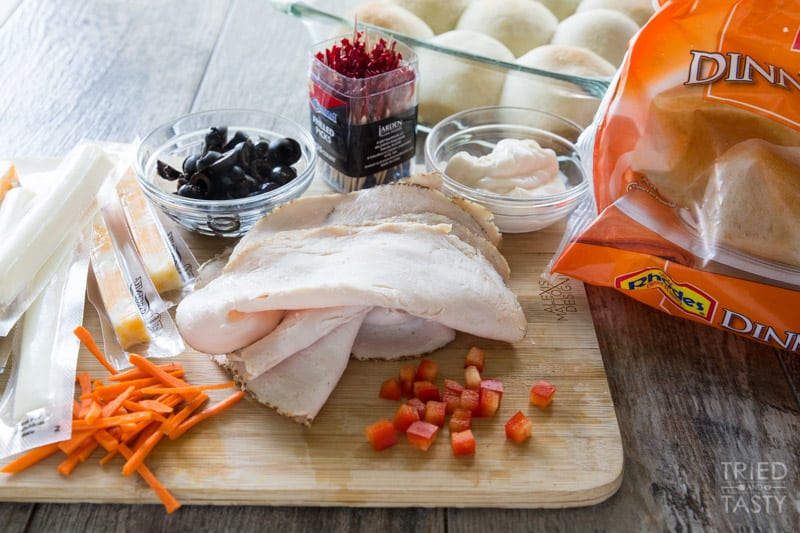 Turkey and Cheese Sammies // These adorable sandwiches will be the talk of the lunchroom. Get kids into the kitchen to make their tasty turkey sandwiches that everyone will want a bite of! | Tried and Tasty