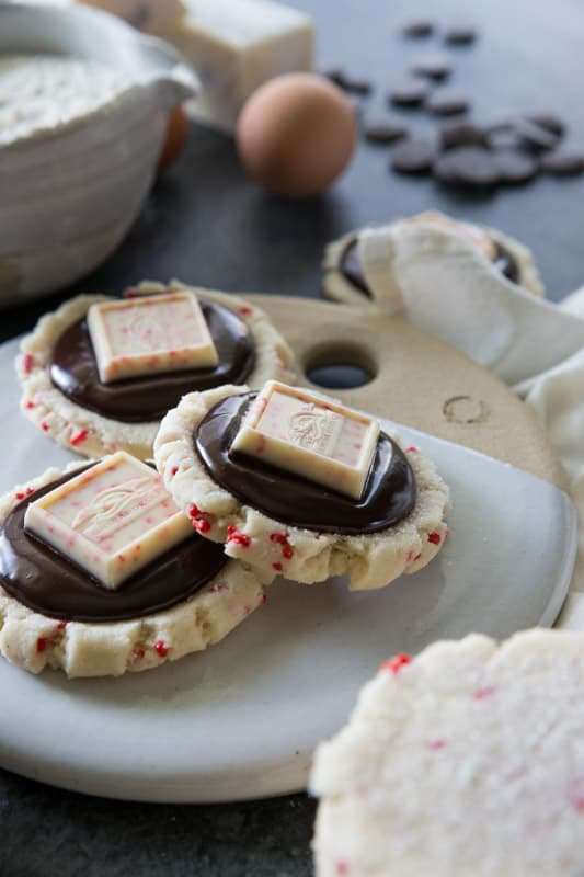Chocolate Peppermint Bark Sugar Cookies // This unique twist on 'peppermint bark' will have you swooning. Chocolate ganache meets the most delicious peppermint sugar cookie! The ultimate holiday cookie (perfect for a cookie exchange)! | Tried and Tasty