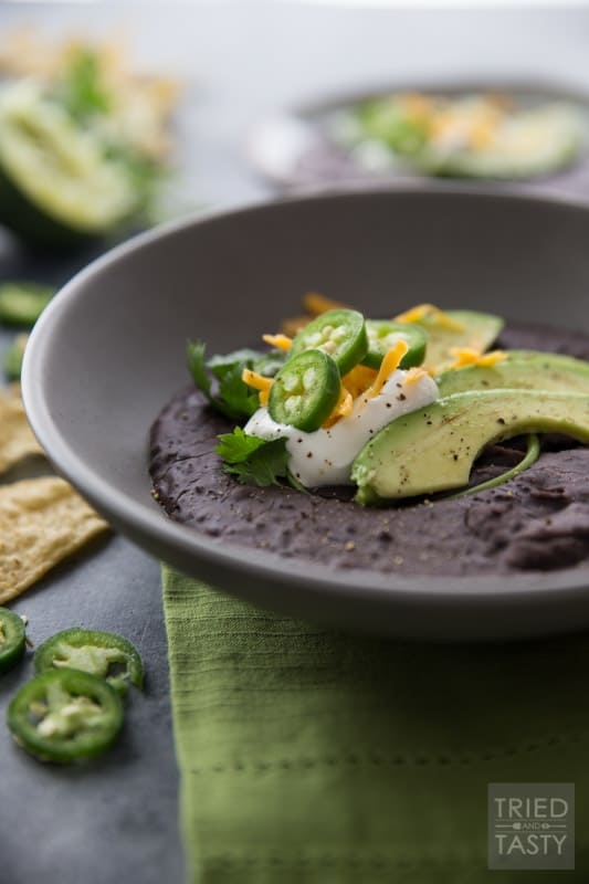 20 Minute Black Bean Soup // This quick and easy meal is absolutely delightful! Black beans are known to support heart health with their fiber, potassium, folate, vitamin B6, phytonutrient content and lack of cholesterol. This soup is an excellent heart healthy meal! | Tried and Tasty