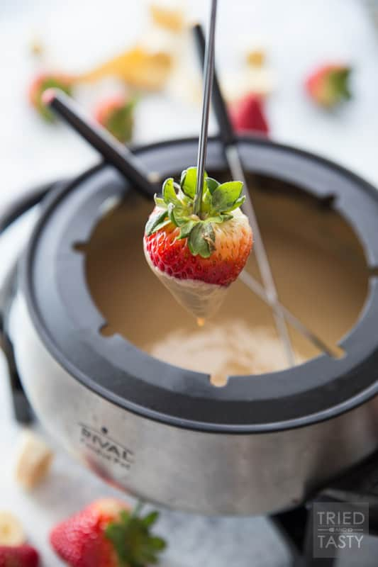 3-Ingredient White Chocolate Peanut Butter Fondue // Calling all fondue lovers! Tried of the traditional milk chocolate? Switch things up a bit with this fun new recipe that will surely tickle your tastebuds in the best way! Serve with your favorite fruit or dippers for a delicious sweet treat. | Tried and Tasty
