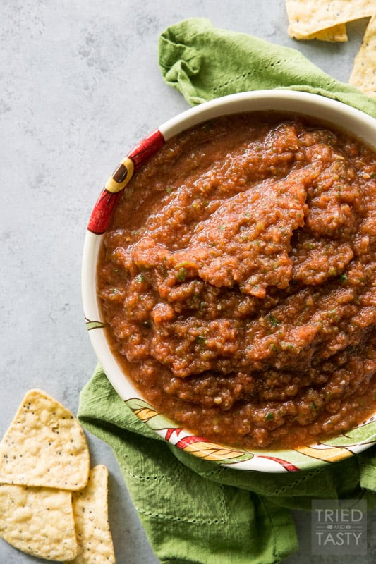 Six-Ingredient Fire Roasted Blender Salsa // Do you love a good salsa? If you've got a blender, then you can have this in less than five minutes! Next time you're at the store pick up everything you need (you probably have most everything on hand already!) and serve this salsa next time you're looking for a great snack!   Tried and Tasty