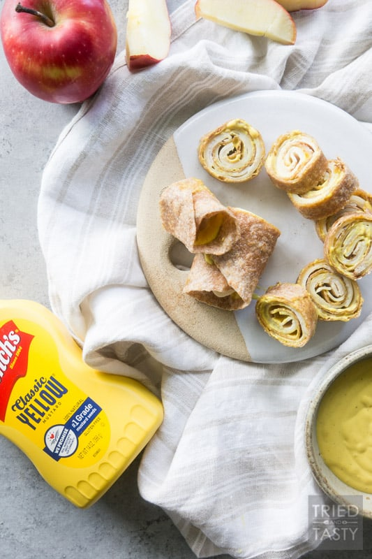 Tangy Turkey and Swiss Pinwheels // Spring into the warm weather with this perfect quick & easy lunch idea. Excellent to pack for your next picnic - made with only a few ingredients and a knockout sauce! | Tried and Tasty