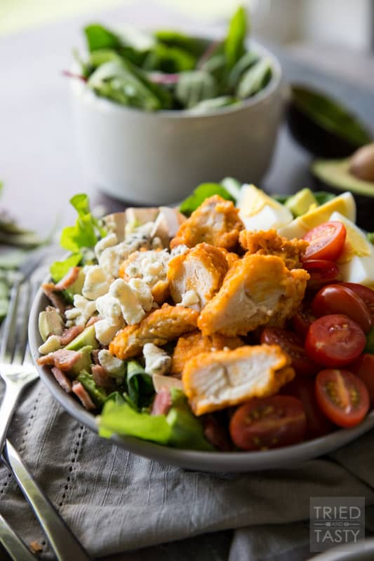 Buffalo Chicken Cobb Salad // Eating 'lighter fare' doesn't have to be tasteless and boring - I'm proving that to you with this delicious flavor packed salad! Comes together super easily and will keep you full through lunchtime and beyond. Take your Cobb salad to the next level, I promise you won't be sorry! | Tried and Tasty