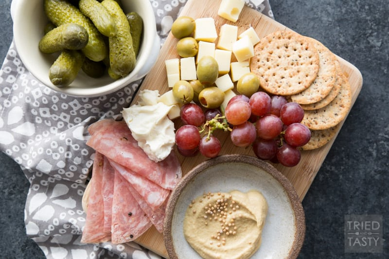 Single Serve Charcuterie // Sometimes you don't need an appetizer or a snack to feed a crowd. Sometimes you just want enough for one - this 'recipe' is just that, perfect single serve portion of the yummiest meat & cheese board! | Tried and Tasty