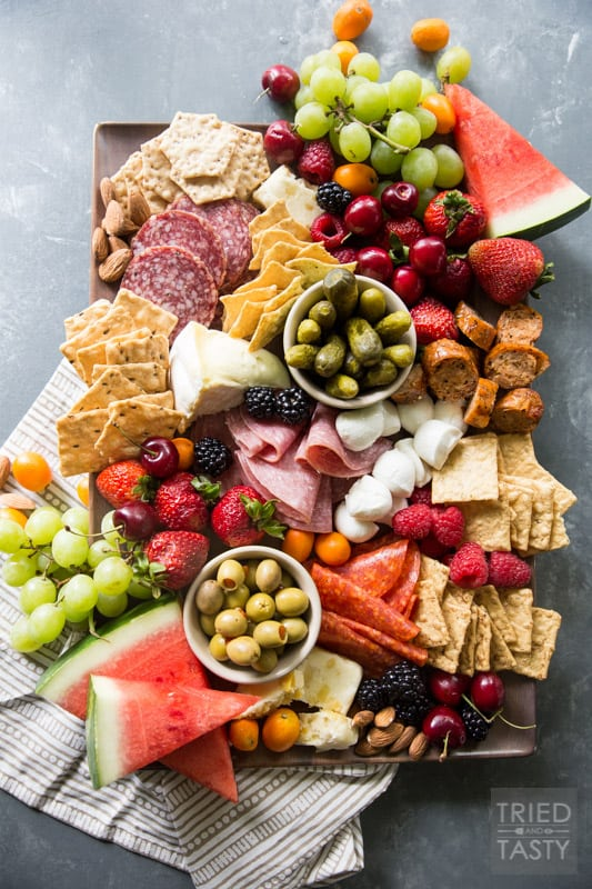 Fruit Lovers Summer Charcuterie // This taste of summer will wow your palate with all your favorite berries, cheeses, meats, and crackers. This is the perfect recipe for entertaining guests this summer! | Tried and Tasty.