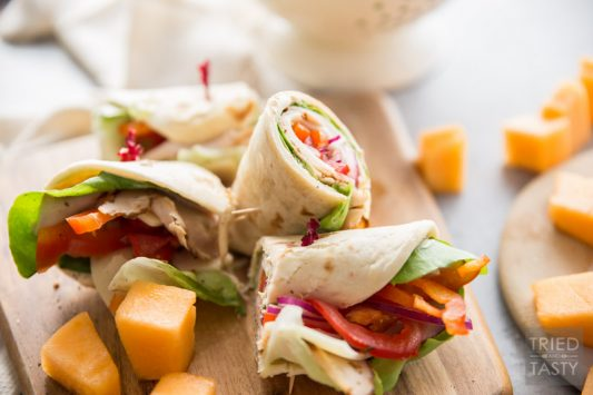 Turkey and Swiss Wrap // Lunch doesn't get easier (or tastier) than this! Start with a high quality tortilla, top with a few of your favorite things, slice and voila! Lunch is served! | Tried and Tasty