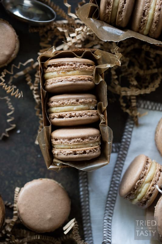 Dark Chocolate Salted Caramel French Macarons | These French Macaron's are as tasty as they are beautiful! Dark Chocolate and Caramel are perfectly fused together between two crispy, airy layers of perfection. | Tried and Tasty