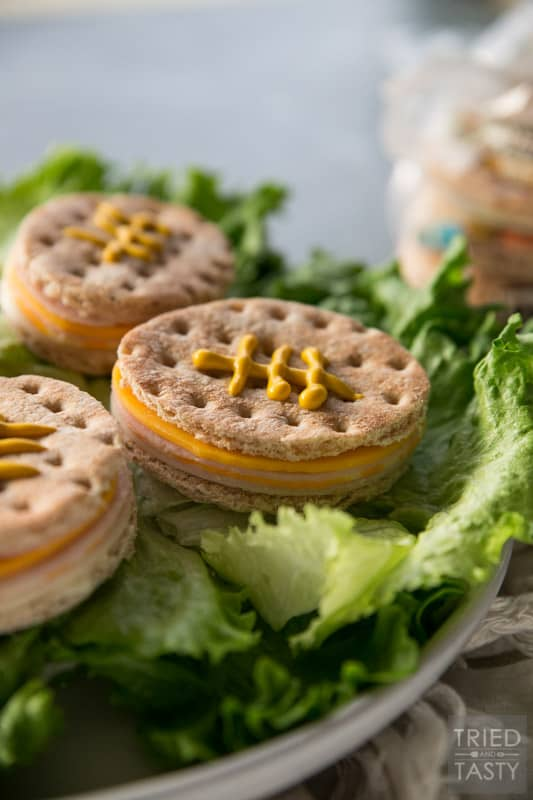 Football Turkey & Cheese Sammies // Game day isn't game day without the best food. These little sammies are the perfect addition to your big party & you won't believe how easy they are! You're only five ingredients away from the perfect football food!   Tried and Tasty