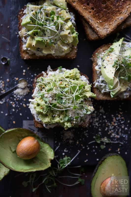 Savory Avocado Toast // This quick and easy snack that could double as breakfast or triple as lunch is simple to make & packed with nutrients! The twist? A smattering of spinach & artichoke dip underneath! | Tried and Tasty