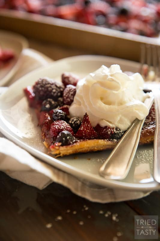 Easy Mixed Berry Tart // Throw together your a mix of your favorite berries into a crunchy pastry crust and you've got an out of this world dessert! Great for those patriotic holidays and all summer long. | Tried and Tasty