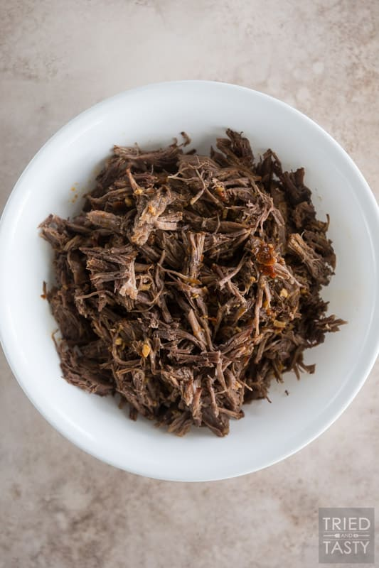 Bowl of shredded barbacoa beef.